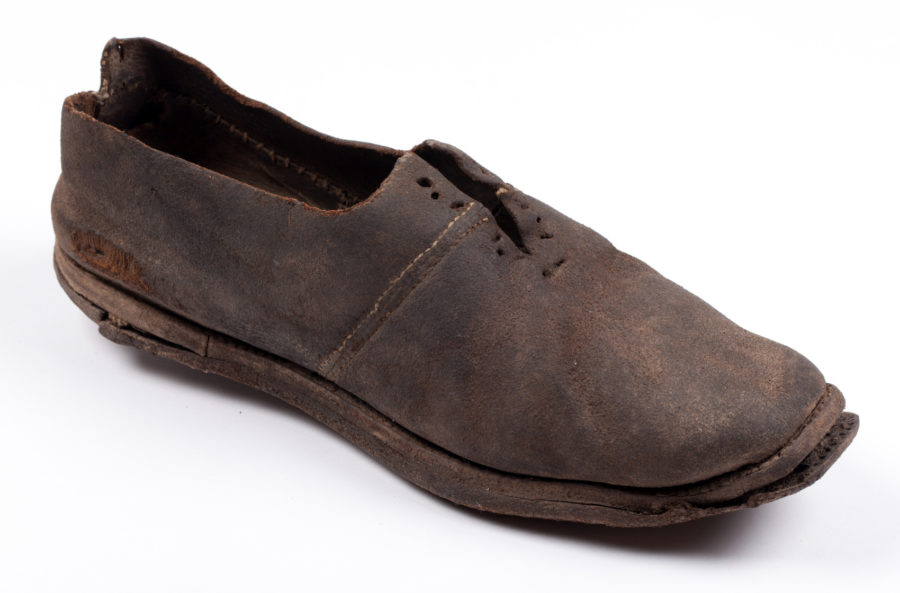 Leather shoe, sole slightly separated from top.