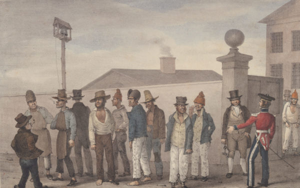 A cartoonish illustration of a line of men being organised by soldiers in front of buildings.