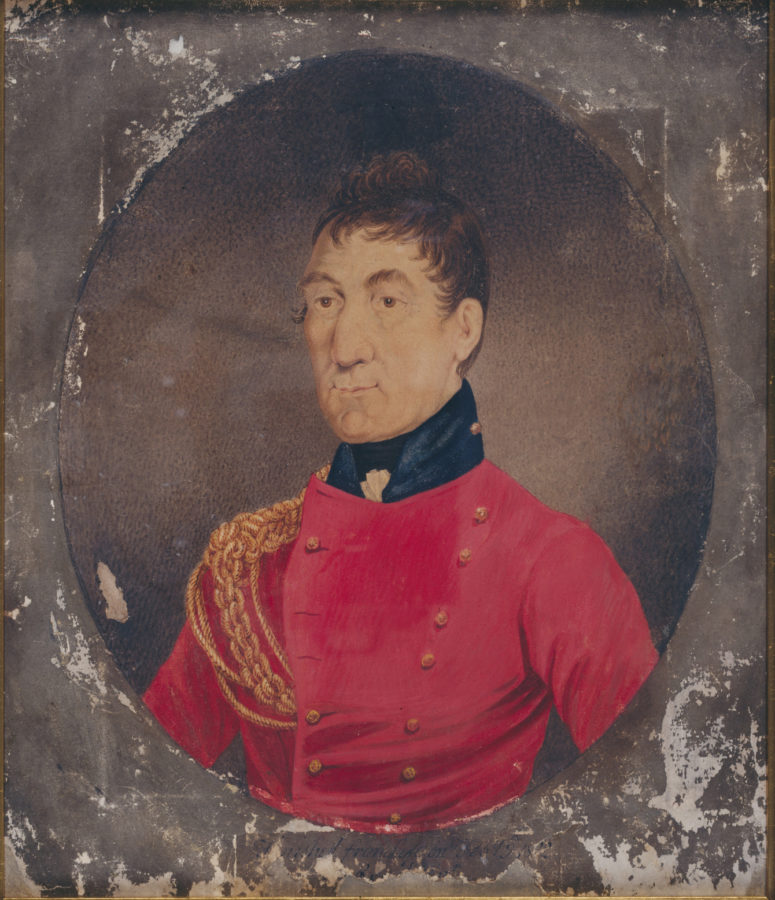 Cameo of man in soldier's red jacket, with black collar and gold braids on right shoulder.