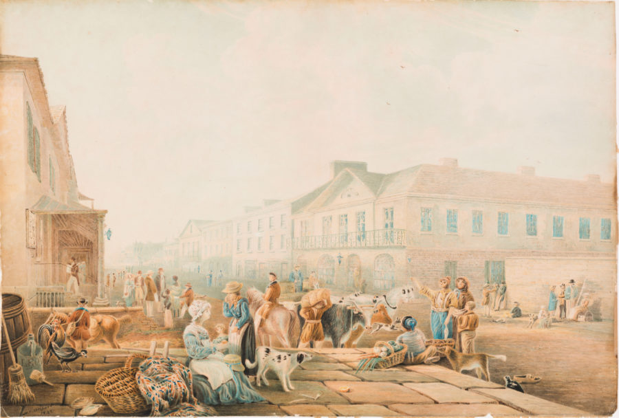 View of busy stone terrace with many people and animals, with city street and buildings fading into distance.