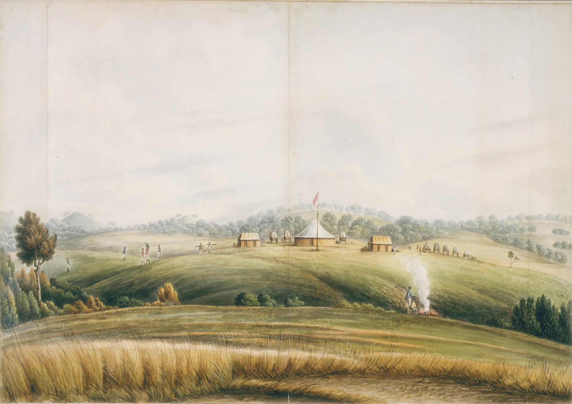 View across cultivated landscape with smoke and farm buildings in distance.