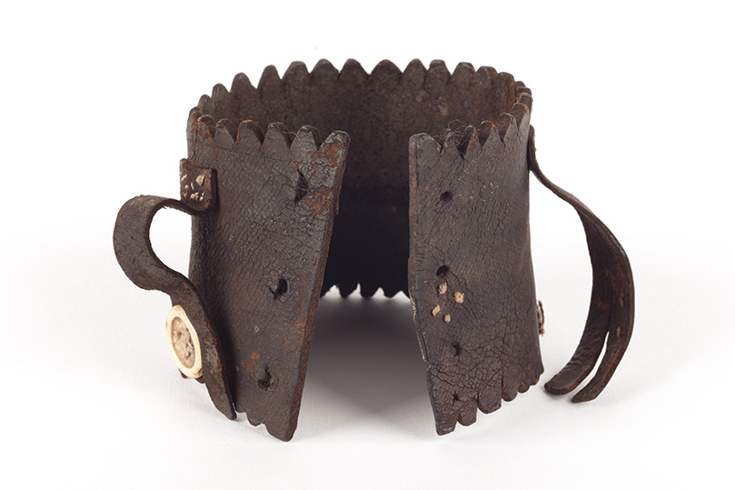Handmade leather cuff with button fastening.