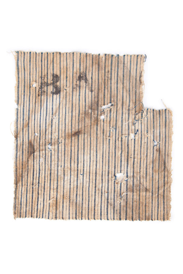 Square striped cloth fragment with BA stamp.