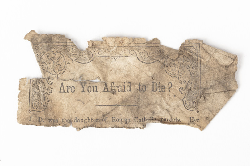 Fragment of paper with decorative border and titled 'Are you afraid to Die?'