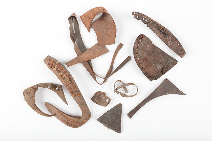 Selection of irregularly shaped leather offcuts.