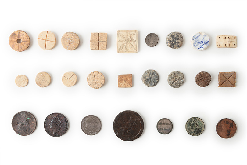 Various tokens and coins, square and round.