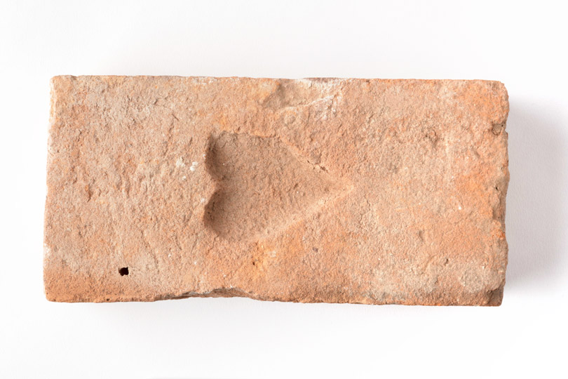 Brick with heart shaped indent